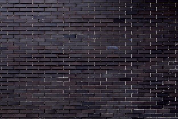 Grijze bakstenen muurtextuur met vuil van bouw die voor achtergrond gebruiken.