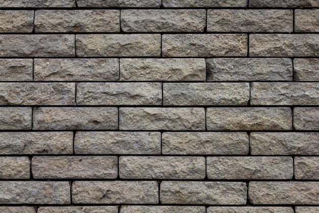 Grijze bakstenen stenen muur textuur