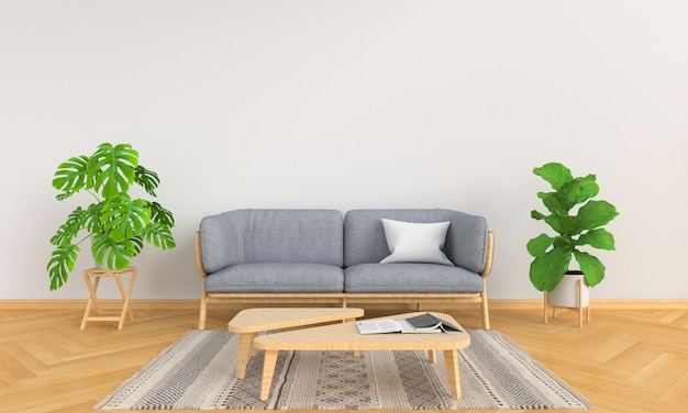 Grijze bank en groene installatie in witte woonkamer