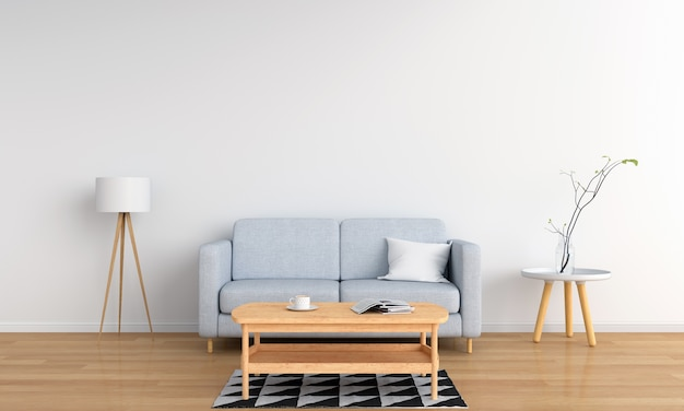 Grijze bank en lamp in witte woonkamer
