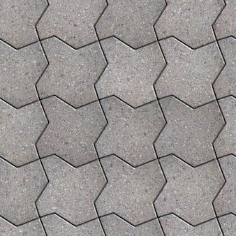 Grijze bestrating als gegolfd vierkant. naadloze tegelbaar textuur.