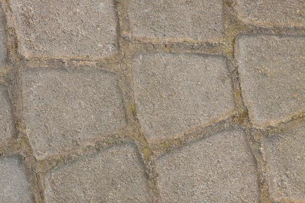 Grijze bestrating - rechthoekig en klein en groot vierkant. naadloze tegelbaar textuur.