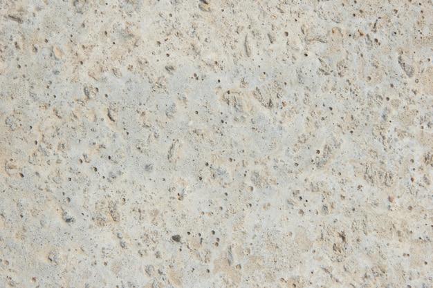 Grijze betonnen achtergrond. een specifieke achtergrond. oud beton.
