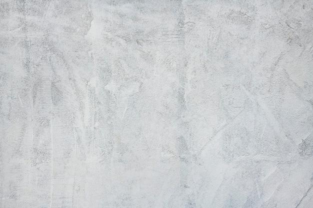 Grijze betonnen getextureerde muur achtergrond