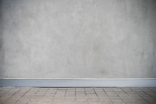Grijze betonnen muur met grunge vloer
