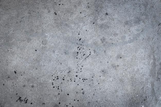 Grijze betonnen textuur een bouwmuur of een betonnen vloer in vuile druppels