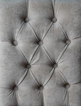Grijze capitone geruite zachte stoffen velours decoratie met knopen
