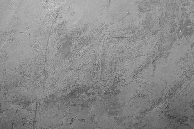 Grijze cement steen gestructureerde achtergrond, donkere betonnen oppervlak