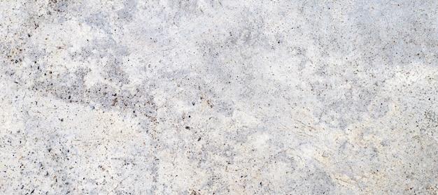Grijze cementmuur of concrete oppervlaktetextuur voor achtergrond.