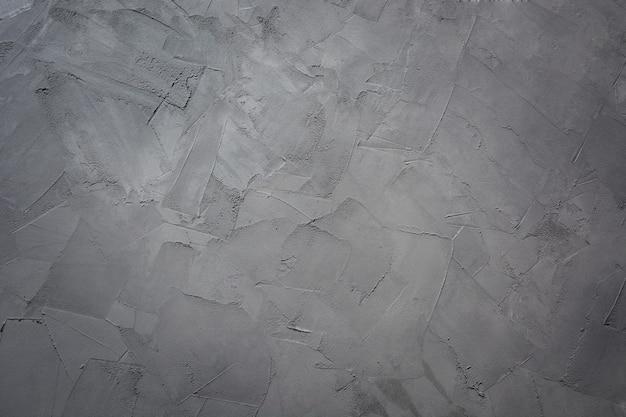 Grijze concrete achtergrond voor ontwerp. textuur. patroon. trendy kleur ultimate grey van het jaar 2021.