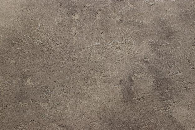 Grijze concrete achtergrondtextuuroppervlakte