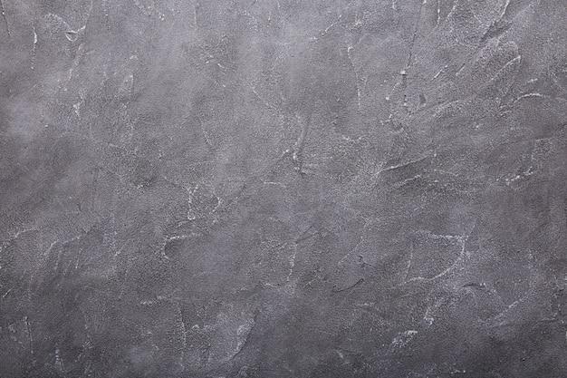 Grijze concrete muur en cementmuurtexturen als achtergrond