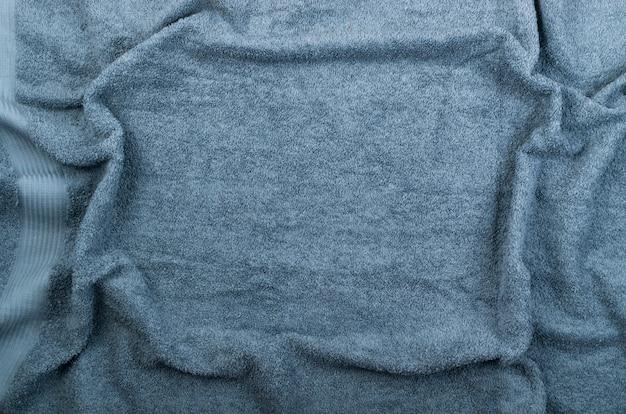 Grijze de golftextuur van de hotelhanddoek of materiële dichte omhooggaand
