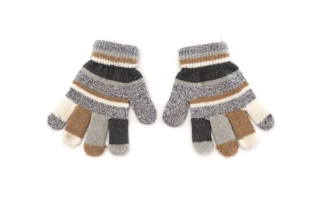 Grijze de winterhandschoenen die op witte achtergrond worden geïsoleerd.