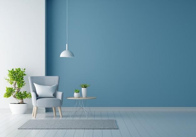 Grijze fauteuil in blauwe woonkamer met kopie ruimte