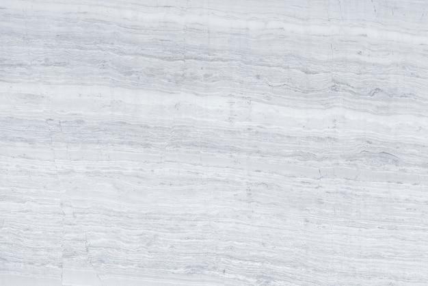 Grijze gelaagde betonnen muur getextureerde achtergrond