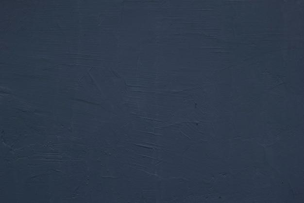 Grijze gepleisterde muur. grijze achtergrond. de textuur van een oude geschilderde muur.
