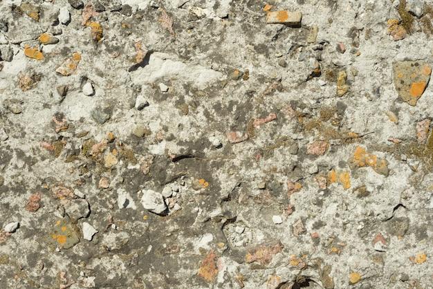 Grijze geweven concrete muurclose-up