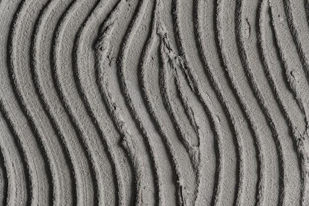Grijze golfpatroon beton getextureerde achtergrond