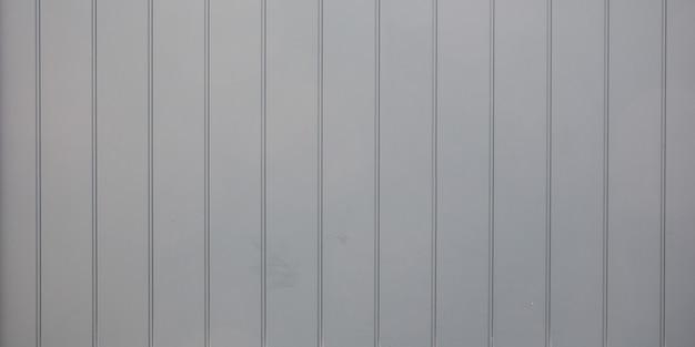 Grijze houten achtergrond met oude geschilderde planken van verweerde geschilderde houten plank