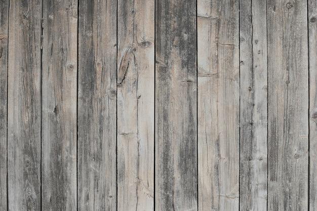 Grijze houten achtergrond. oude grijze houten hek textuur.