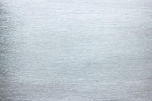 Grijze ijzeren plaat met krassen, metalen structuur met chroomglans