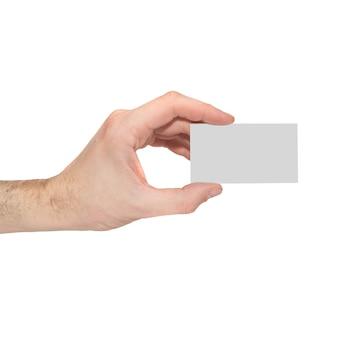 Grijze kaartspatie in een hand die op wit wordt geïsoleerd.
