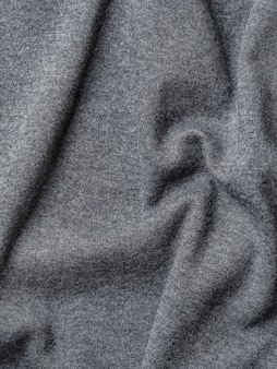 Grijze katoenen stoffentextuur. kleding katoenen jersey achtergrond met vouwen