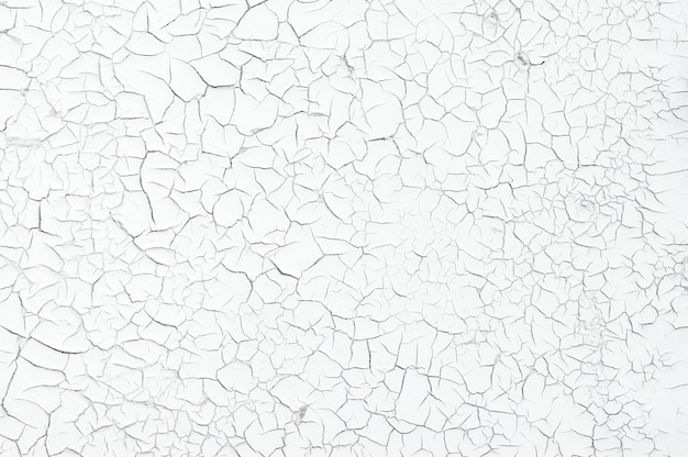 Grijze kleur droog gebarsten modderige aarde als achtergrond textuur