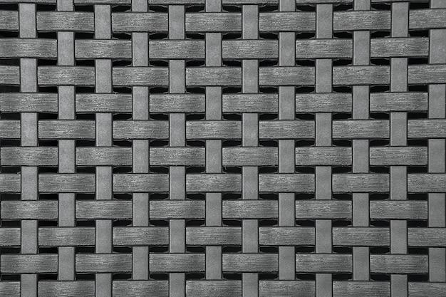 Grijze kunststof rieten textuur, verweerde bruine achtergrondpatroon