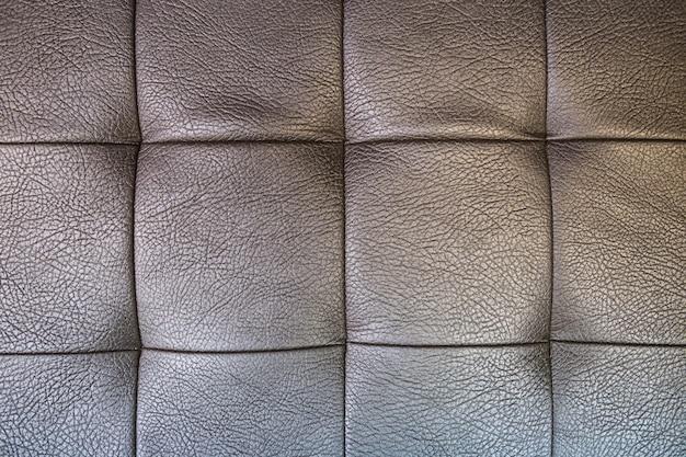 Grijze lederen textuur met vierkanten