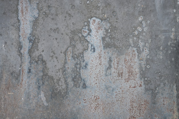 Grijze metalen achtergrond met textuur. gegoten verf. metalen textuur