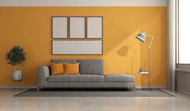 Grijze moderne bank in een minimalistische ruimte met sinaasappelenmuren - 3d renderimg