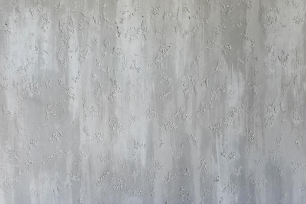 Grijze muur met reliëf textuur