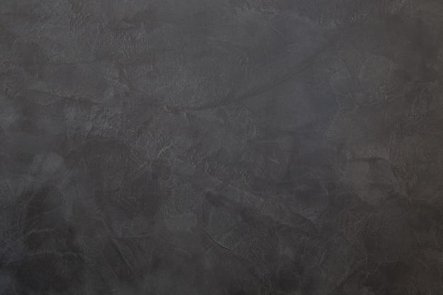 Grijze muurtextuur, grijze muurachtergrond.
