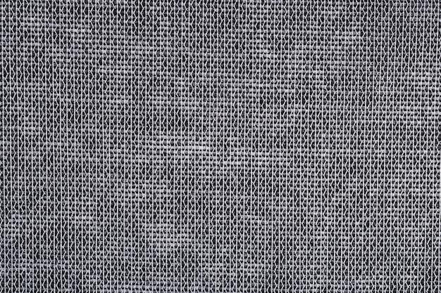 Grijze niet-geweven stof textuur achtergrond