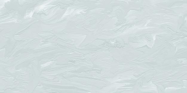 Grijze olieverf op een muur, ruwe penseelstreken op canvas, abstracte papieren achtergronden. uitgesmeerd abstract structuurpatroon. tekenoppervlak.
