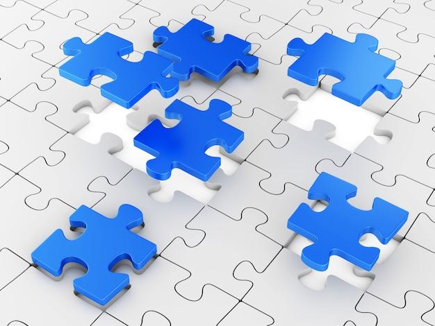 Grijze puzzel met blauwe stukjes zwevend