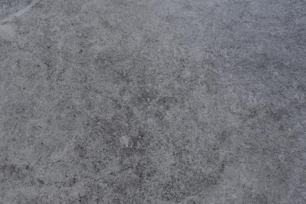 Grijze rommelige muur oppervlakte achtergrond