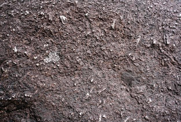 Grijze ruige steen geweven achtergrond.