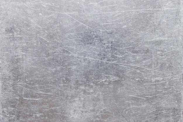 Grijze stalen plaat textuur, grunge metalen achtergrond met zilverachtige glans