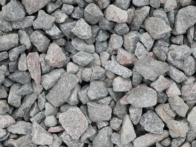 Grijze steentjes. detailopname. metselwerk, material, surface, flat, front, view, pattern, abstract, background, design. steentjes van grijze kleur.