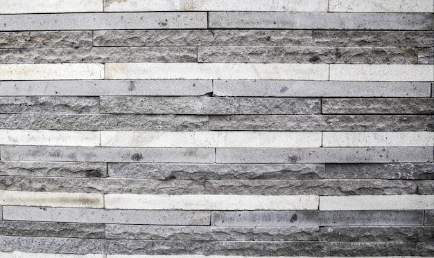 Grijze stenen bakstenen op een rij. kan als achtergrond worden gebruikt