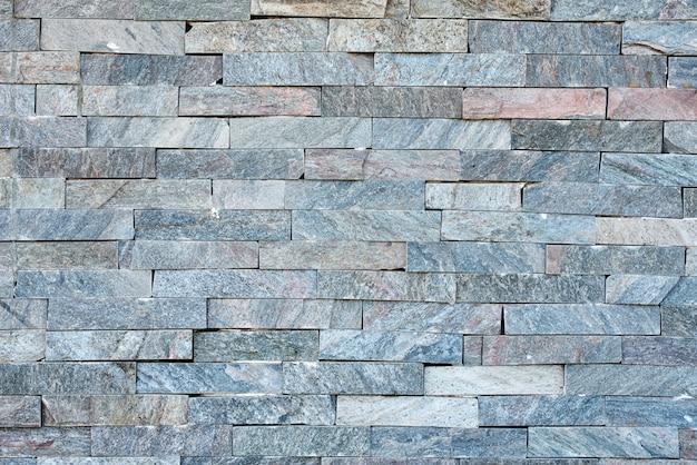 Grijze stenen muur als achtergrond. abstracte textuur