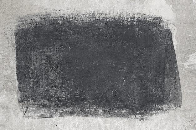 Grijze stenen muur met een zwarte vlek. achtergrond, textuur