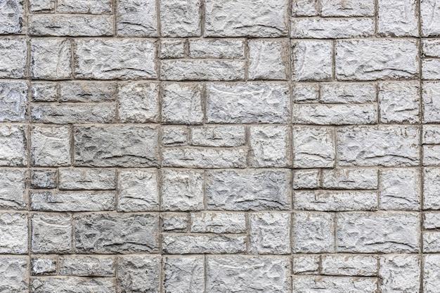 Grijze stenen muur van textuurtegels. hoge kwaliteit foto