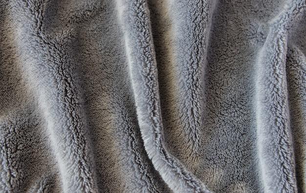 Grijze textuurstof of stoffen textiel.