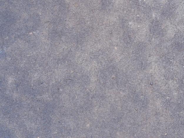 Grijze thermische isolatiestof close-up textuur