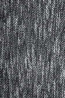 Grijze tweedachtige structuur, grijs wolpatroon, zwart-wit gemêleerde bekleding in zout- en peperstijl. stof achtergrond kopie ruimte
