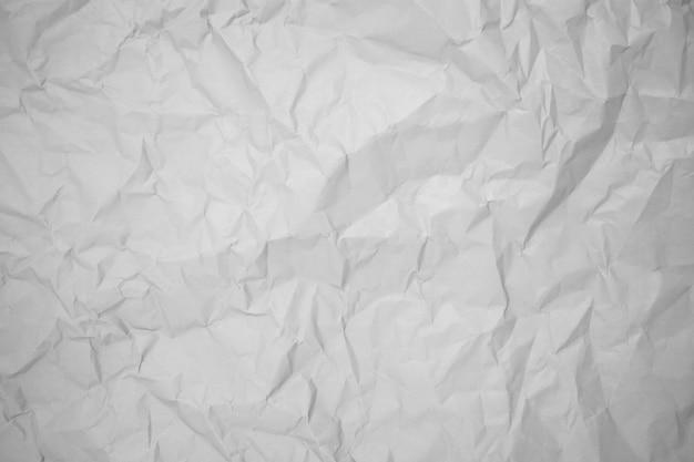 Grijze verfrommeld papier achtergrondstructuur